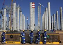 Workers are seen in front the construction site of Eskom's Medupi power station, a new dry-cooled coal fired power station, in Limpopo province, in a file photo. REUTERS/Siphiwe Sibeko