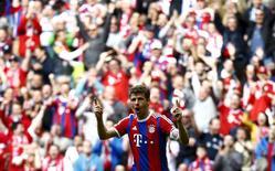 Thomas Mueller, de Bayern de Munique, comemora gol em partida em Munique. 11/04/2015 REUTERS/Kai Pfaffenbach