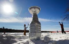 A replica of the Stanley Cup, made from a water jug and some bowls from a dollar store, adorn a pond hockey game on Sturgeon Lake in the region of Kawartha Lakes, Ontario February 2, 2015.  REUTERS/Fred Thornhill