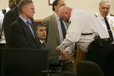 A court officer places handcuffs on the wrists of former NFL player Aaron Hernandez after the guilty verdict was read during his murder trial at the Bristol County Superior Court in Fall River, Massachusetts, April 15, 2015. REUTERS/Dominick Reuter