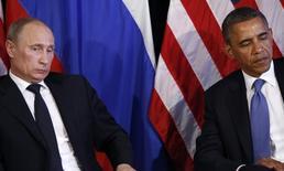 Владимир Путин и Барак Обама на встрече в Лос-Кабосе в Мексике. 18 июня 2012 года. Лидер подвергнутой санкциям России высказался за сотрудничество с Западом, но предостерег США от того, что назвал отношениями супердержавы с вассалами. REUTERS/Jason Reed