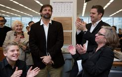 New York Times employees celebrate in New York April 20, 2015 as the newspaper wins three Pulitzer prizes in this handout photo. Daniel Berehulak, center, won the Feature Photography award. At right are Michele McNally, AME for Photgraphy and Foreign Photo Editor, David Furst. REUTERS/Ruth Fremson/The New York Times/Handout via Reuters ATTENTION EDITORS - NO SALES. NO ARCHIVES. THIS IMAGE HAS BEEN SUPPLIED BY A THIRD PARTY. IT IS DISTRIBUTED, EXACTLY AS RECEIVED BY REUTERS, AS A SERVICE TO CLIENTS. FOR EDITORIAL USE ONLY. NOT FOR SALE FOR MARKETING OR ADVERTISING CAMPAIGNS. NO COMMERCIAL USE.