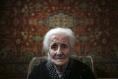 Silvard Atajyan, 103, sits at home during an interview with Reuters in Yerevan, April 20, 2015.  REUTERS/David Mdzinarishvili