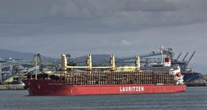 A ship called the Milau Bulker carries a load of unprocessed logs as it departs from the Burrard Inlet in Vancouver, British Columbia October 16, 2012. REUTERS/Andy Clark