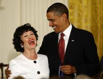 U.S. President Barack Obama laughs with entertainer Chita Rivera as he presents her with the Medal of Freedom during a ceremony in the East Room of the White House in Washington, August 12, 2009. REUTERS/Jason Reed