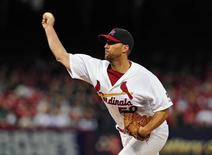 Apr 19, 2015; St. Louis, MO, USA; St. Louis Cardinals starting pitcher Adam Wainwright (50) throws to a Cincinnati Reds batter during the first inning at Busch Stadium. Mandatory Credit: Jeff Curry-USA TODAY Sports
