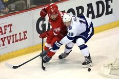 Apr 21, 2015; Detroit, MI, USA; Detroit Red Wings defenseman Niklas Kronwall (55) and Tampa Bay Lightning left wing Ondrej Palat (18) battle for the pocket in the second period of game three of the first round of the 2015 Stanley Cup Playoffs at Joe Louis Arena. Mandatory Credit: Andrew Weber-USA TODAY Sports