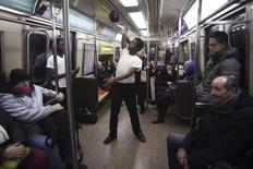 A performer dances to Michael Jackson music on the R train as it pulls into Times Square on New Year's Eve in New York December 31, 2014.    REUTERS/Carlo Allegri