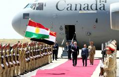 Canada's Prime Minister Stephen Harper (center L) and Iraq's Kurdish regional President Massoud Barzani walk during a welcoming ceremony after arriving at the airport in Erbil, Iraq May 2, 2015. REUTERS/Azad Lashkari
