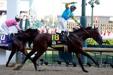 May 2, 2015; Louisville, KY, USA; Victor Espinoza aboard American Pharoah celebrates winning the 141st Kentucky Derby at Churchill Downs. Mandatory Credit: Peter Casey-USA TODAY Sports