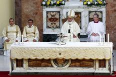 Pope Francis celebrates a mass during his pastoral visit to the Church of S. Maria Regina Pacis in Ostia, near Rome May 3, 2015. REUTERS/Giampiero Sposito