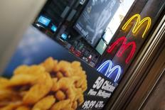 Neon McDonald's Golden Arches are seen outside the Times Square location in New York January 29, 2015.  REUTERS/Shannon Stapleton