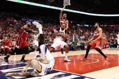 May 5, 2015; Atlanta, GA, USA; Atlanta Hawks center Al Horford (15) is defended by Washington Wizards forward Otto Porter Jr. (22) during the second half in game two of the second round of the NBA Playoffs at Philips Arena. The Hawks defeated the Wizards 106-90.  Mandatory Credit: Dale Zanine-USA TODAY Sports