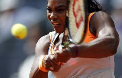 Serena Williams of the U.S. returns the ball to Victoria Azarenka of Belarus during their match at the Madrid Open tennis tournament in Madrid, Spain, May 6, 2015. REUTERS/Susana Vera