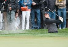 May 3, 2015; San Francisco, CA, USA; Rory McIlroy chips to the green at the eleventh hole during day five of the World Golf Championships-Cadillac Match Play at TPC Harding Park. Mandatory Credit: Ed Szczepanski-USA TODAY