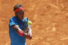 Rafael Nadal of Spain returns the ball to Simone Bolelli of Italy during their match at the Madrid Open tennis tournament in Madrid, Spain, May 7, 2015. REUTERS/Juan Medina