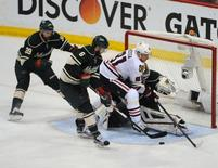 May 7, 2015; Saint Paul, MN, USA;  Chicago Blackhawks forward Marian Hossa (81) looks for a rebound after a save by Minnesota Wild goalie Devan Dubnyk (40) during the third period in game four of the second round of the 2015 Stanley Cup Playoffs at Xcel Energy Center. The Blackhawks defeated the Wild 4-3 sweeping the second round of playoffs.  Mandatory Credit: Marilyn Indahl-USA TODAY Sports
