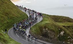 The peloton makes its way along the causeway coast on the north Antrim coast on the second stage of the Giro d'Italia cycling race May 10, 2014. REUTERS/Cathal McNaughton