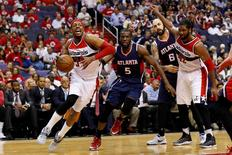 May 9, 2015; Washington, DC, USA; Washington Wizards forward Paul Pierce (34) drives to the basket past Atlanta Hawks forward DeMarre Carroll (5) in the third quarter in game three of the second round of the NBA Playoffs. at Verizon Center. The Wizards won 103-101. Mandatory Credit: Geoff Burke-USA TODAY Sports