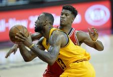 Cleveland Cavaliers forward LeBron James (23) drives to the basket against Chicago Bulls guard Jimmy Butler (21) in the second quarter in game five of the second round of the NBA Playoffs at Quicken Loans Arena. Mandatory Credit: David Richard-USA TODAY Sports
