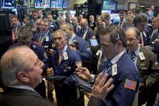 Traders work on the floor of the New York Stock Exchange May 12, 2015. REUTERS/Brendan McDermid