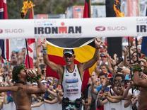 File photo of professional male triathlete Frederik Van Lierde of Belgium celebrates after winning the Ironman World Championship in Kailua-Kona, Hawaii, October 12, 2013. REUTERS/Hugh Gentry