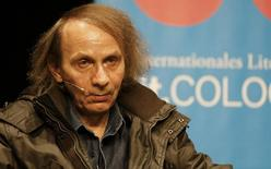 French author Michel Houellebecq sits on stage of the Schauspiel Koeln, the public theater of the western German city of Cologne January 19, 2015. REUTERS/Wolfgang Rattay