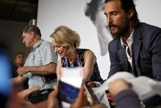 """Cast members Naomi Watts (C) and Matthew McConaughey (R), and director Gus Van Sant (L) sign autographs after a news conference for the film """"The Sea of Trees"""" in competition at the 68th Cannes Film Festival in Cannes, southern France, May 16, 2015.          REUTERS/Benoit Tessier"""