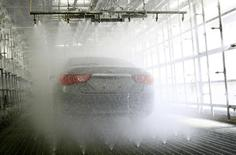 A Toyota Motor Corp car is seen during a hi-function shower test demonstration at the quality-control facility in Toyota, central Japan March 30, 2010.    REUTERS/Kim Kyung-Hoon