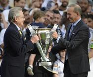 MLS commissioner Don Garber (right) presents Los Angeles Galaxy owner Philip Anschutz (left) with the MLS Cup championship trophy after the 2014 MLS Cup final at Stubhub Center. Dec 7, 2014; Los Angeles, CA, USA; Kelvin Kuo-USA TODAY Sports