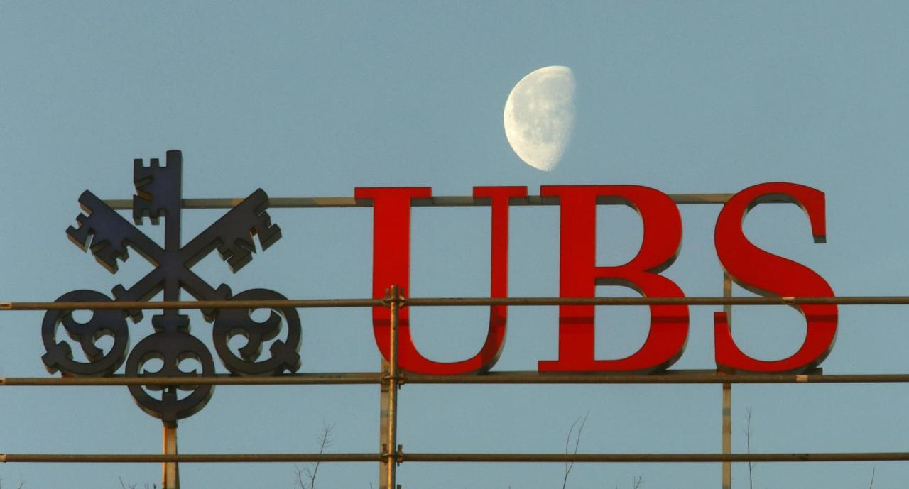 Global banks admit guilt in forex probe fined nearly 6 billion a file picture shows the waning moon behind a logo of swiss bank ubs in zurich switzerland february 10 2015 reutersarnd wiegmannfiles buycottarizona Image collections