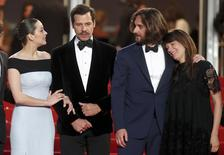 """(L-R) Actress Marion Cotillard and actor Laurent Lafitte, producer Dimitri Rassam and singer Camille pose on the red carpet as they leave after the screening of the animated film """"The Little Prince """" (Le Petit Prince) out of competition at the 68th Cannes Film Festival in Cannes, southern France, May 22, 2015.                    REUTERS/Benoit Tessier"""