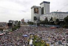 Catholic faithful attend the beatification ceremony of the late Archbishop of San Salvador Oscar Arnulfo Romero at El Salvador del Mundo square in San Salvador, May 23, 2015. REUTERS/Jorge Dan Lopez