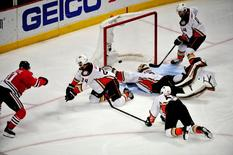 May 23, 2015; Chicago, IL, USA; Chicago Blackhawks center Antoine Vermette (80) scores the game winning goal against the Anaheim Ducks during the second overtime period in game four of the Western Conference Final of the 2015 Stanley Cup Playoffs at United Center. David Banks-USA TODAY Sports