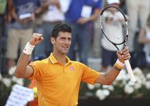 Novak Djokovic of Serbia celebrates winning against Roger Federer of Switzerland after their final match at the Rome Open tennis tournament in Rome, Italy, May 17, 2015. REUTERS/Stefano Rellandini