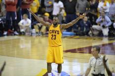 Cleveland Cavaliers forward LeBron James (23) celebrates against the Atlanta Hawks in game three of the Eastern Conference Finals of the NBA Playoffs at Quicken Loans Arena. Mandatory Credit: David Richard-USA TODAY Sports