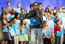 Jenna-May Ingal of Riverside, California, reacts to making the semi-finals of the 88th annual Scripps National Spelling Bee at National Harbor, Maryland May 27, 2015.    REUTERS/Joshua Roberts