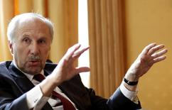 European Central Bank Governing Council member and chief of Austria's central bank Ewald Nowotny gestures during an interview with Reuters in Vienna, Austria, May 8, 2015. REUTERS/Leonhard Foeger