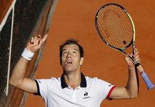 Richard Gasquet of France celebrates after beating Kevin Anderson of South Africa during their men's singles match at the French Open tennis tournament at the Roland Garros stadium in Paris, France, May 30, 2015.             REUTERS/Pascal Rossignol