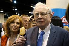 Berkshire Hathaway CEO Warren Buffett enjoys a Dairy Queen ice cream bar prior to the Berkshire annual meeting in Omaha, Nebraska, United States, in this file photo taken May 2, 2015. REUTERS/Rick Wilking/Files