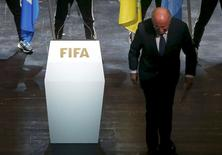 FIFA President Sepp Blatter leaves the stage after making a speech during the opening ceremony of the 65th FIFA Congress in Zurich, Switzerland, in this May 28, 2015 file photo. REUTERS/Arnd Wiegmann/Files