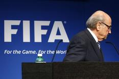 FIFA President Sepp Blatter leaves after his statement during a news conference at the FIFA headquarters in Zurich, Switzerland, June 2, 2015.  REUTERS/Ruben Sprich
