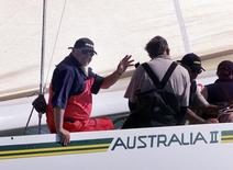 File photo of Alan Bond on board Australia 2 as it competes in the Round the Island race of the Americas Cup Jubilee Regatta August 21, 2001 off the coast of Cowes Isle of Wight.