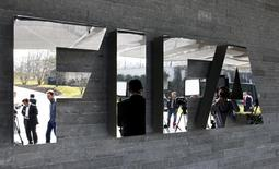 Journalists are reflected in the FIFA logo as they wait for a news conference after a meeting of the FIFA executive committee in Zurich March 20, 2015. REUTERS/Arnd Wiegmann