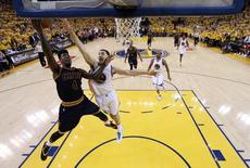 Jun 7, 2015; Oakland, CA, USA; Cleveland Cavaliers guard Iman Shumpert (4) shoots the ball against Golden State Warriors guard Klay Thompson (11) in game two of the NBA Finals at Oracle Arena. Ezra Shaw-Pool Photo via USA TODAY Sports