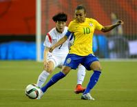 Jun 9, 2015; Montreal, Quebec, CAN; Brazil midfielder Marta (10) controls the ball in front of Korea Republic defender Lee Eunmi (2) in the second half a Group E soccer match in the 2015 FIFA women's World Cup at Olympic Stadium. Mandatory Credit: Eric Bolte-USA TODAY Sports