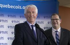 Gilles Duceppe (L) and Mario Beaulieu smile during a news conference to announce Duceppe's return to federal politics as leader of the Bloc Quebecois, in Montreal June 10, 2015.  REUTERS/Christinne Muschi