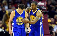 Jun 11, 2015; Cleveland, OH, USA; Golden State Warriors guard Andre Iguodala (9) celebrates with guard Stephen Curry (30) during the fourth quarter against the Cleveland Cavaliers in game four of the NBA Finals at Quicken Loans Arena. Mandatory Credit: Bob Donnan-USA TODAY Sports