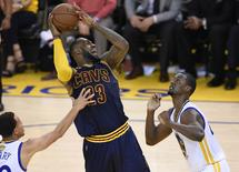 Cleveland Cavaliers forward LeBron James moves to the basket against the defense of Golden State Warriors guard Stephen Curry and forward Harrison Barnes during the first half in game two. Bob Donnan-USA TODAY Sports