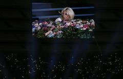 Singer Lady Gaga is displayed on a videowall while fans light their phones during the opening ceremony of the 1st European Games in Baku, Azerbaijan, June 12 , 2015.  REUTERS/Stoyan Nenov
